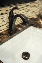 Undermount sink, delta faucet marble mosaic backsplash, marble countertop