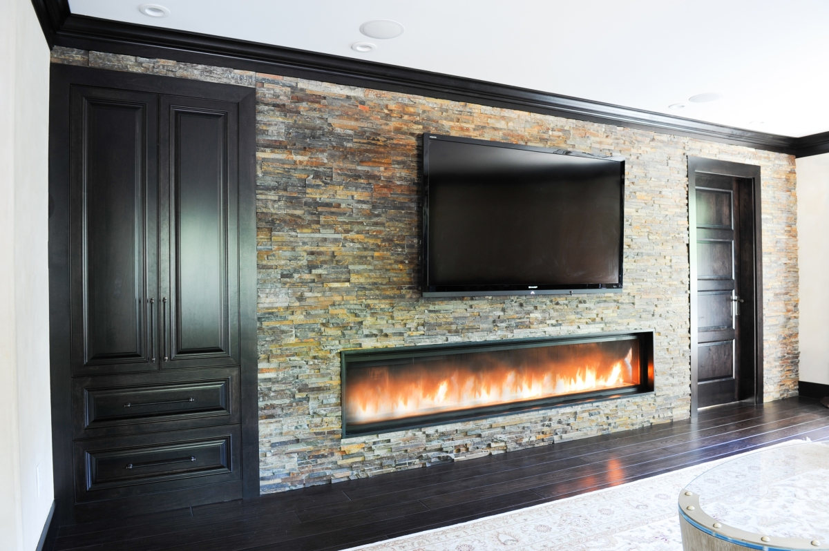 "8'-0"" custom fireplace, built in storage, ledge stone, flat screen tv"