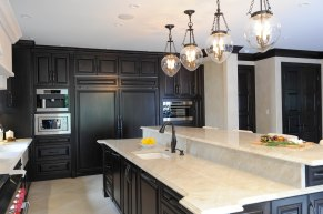 Sub-Zero built in refrigeration, pendant lighting, TajMahalQuartzite countertops, caesarstone countertops