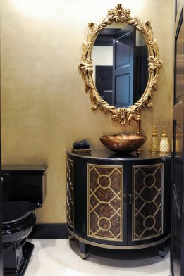 Powder room, gold leaf walls, old world mirror, freestanding vanity, glass vessekl sink